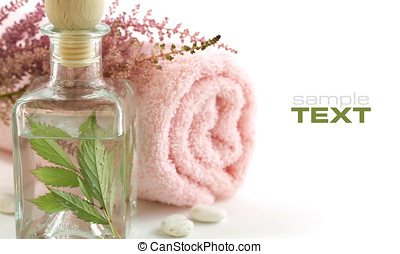 Jar with fresh leaves and towel (SPA concept). With sample...