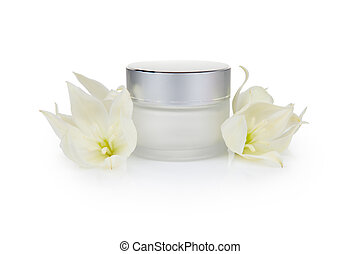 Jar with the cosmetic cream and flowers isolated on white