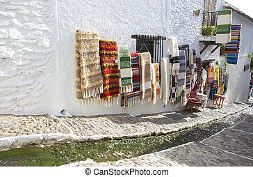 Jarapas displayed over walls of handicraft shop