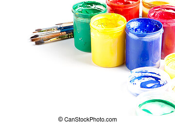 Jars of brightly coloured paint with brushes - Jars of...