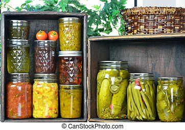 Jars of home canned food - Two wooden boxes full of a...