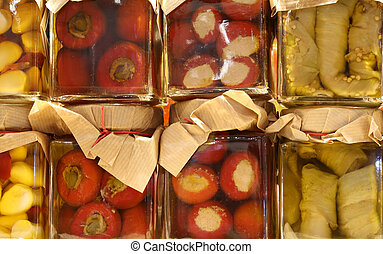 jars of Italian products preserved in oil with green peppers gar
