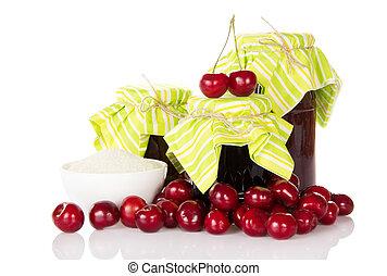 Jars of jam and hill sweet cherries