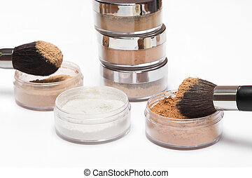 Jars of loose cosmetic powder different colors