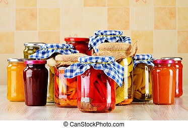 Jars of marinated food. Pickled vegetables and jams -...