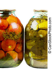 Jars of pickles and tomatoes
