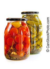 Jars of pickles - Two clear glass jars of colorful pickled...