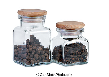 Jars of spices on a white background