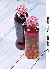 Jars with cherry liqueur