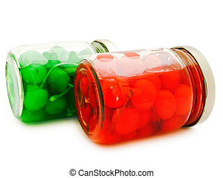 jars with cherry - two jars with green and red cherry ...