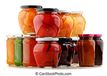 Jars with fruity compotes and jams. Preserved fruits.