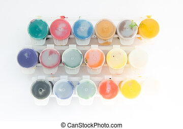 jars with gouache paints on a white background