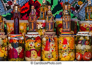 Jars with pickles and bottles with alcohol 1