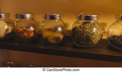 Jars with spices on shelves
