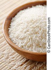 Jasmin rice - Wooden bowl full of jasmin rice variety