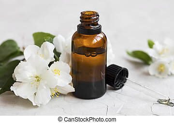 Jasmine essential oil. Bottle of jasmine aromatherapy oil with dropper