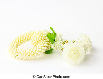 Jasmine garland on a white background (craft plastic, not...