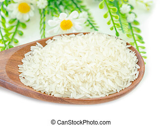 Jasmine rice in wooden spoon.