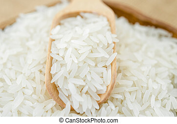 Jasmine rice with wooden spoon.