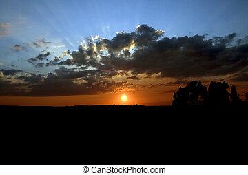 jasny, zachód słońca