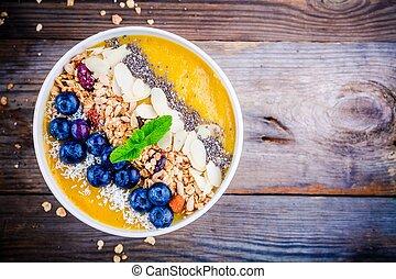 jaune, smoothies, bol, à, myrtilles, granola, chia, graines, et, amandes