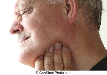 Jaw pain in older man - senior man with soreness in his jaw...