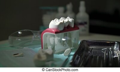 Jaw teeth and tools in dental clinic