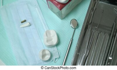 Jaw teeth and tools in dental clinic closeup
