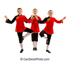 A trio of three jazz dancers in Asian inspired recital costume
