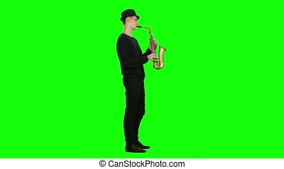 Jazz melodies performed by young musician on the saxophone....