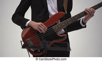 Jazz musician plays bass in a band