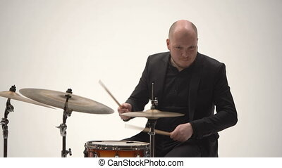 Jazz musician playing drums in a band