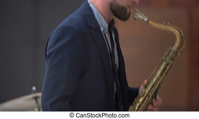 Jazz musician plays the saxophone in a band