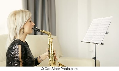 Jazz saxophone player performing on the sax in the living...