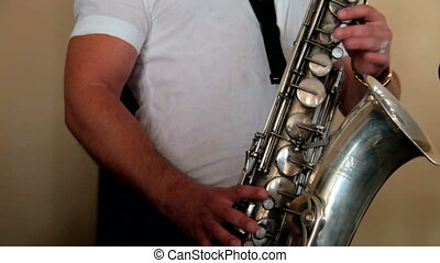 Jazz - The jazz musician plays on a saxophone