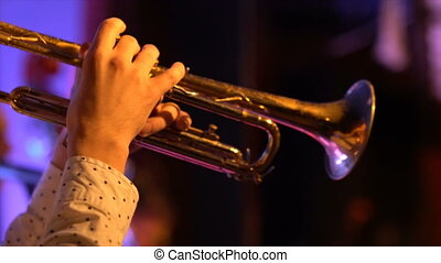 Jazz trumpet player, playing at stage