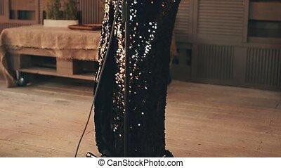 Jazz vocalist in stunning dress perform on stage. Elegant. Microphone. Dance