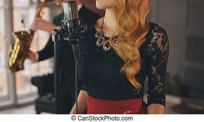Jazz vocalist perform on stage with saxophonist. Click...