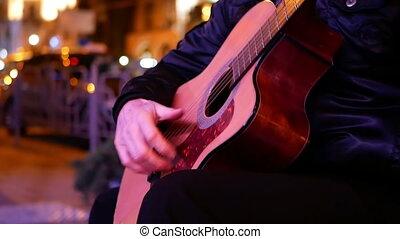 Jazzy guitarist night streets. - Jazzy guitarist performing...