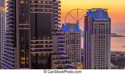 JBR and Bluewaters island after sunset aerial day to night timelapse