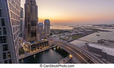JBR and Dubai marina after sunset aerial day to night timelapse