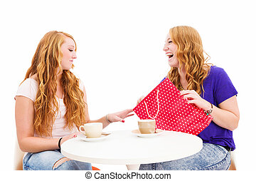 jealous woman looking at the shopping bag of her happy friend