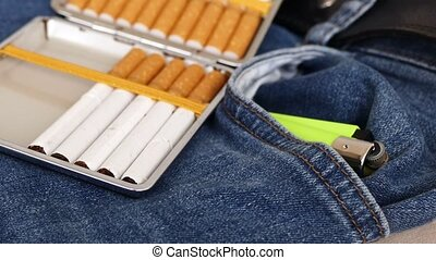 jeans and tobacco (cigarette) on it,