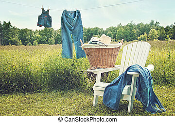 Jeans hanging on clothesline on a summer afternoon