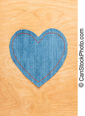 Jeans heart on wooden background