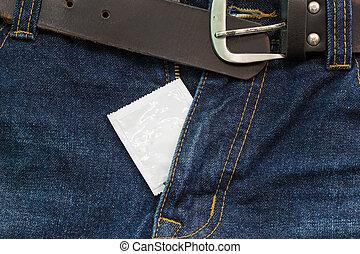jeans open zip with condom, safe sex concept