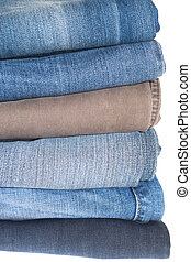 Jeans pile isolated on white background.