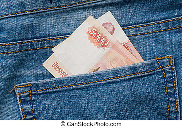 Jeans pocket with banknotes of five thousand Russian rubles