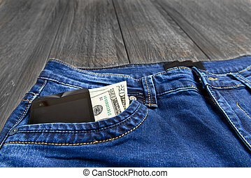 jeans pocket with money and phone