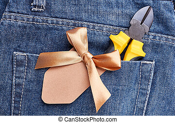 Jeans poket with pliers.